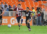 D.C. United forward Charlie Davies (9) shields the ball against Chivas USA midfielder Ben Zemanski (21). Chivas USA tied D.C. United 2-2 at RFK Stadium, Wednesday  September 20 , 2011.