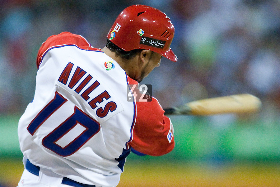 7 March 2009: #10 Michael Aviles of Puerto Rico hits the ball during the 2009 World Baseball Classic Pool D match at Hiram Bithorn Stadium in San Juan, Puerto Rico. Puerto Rico wins 7-0 over Panama.