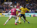 Bukayo Saka of Arsenal takes on Jeff Hendrick and Matthew Lowton of Burnley during the Premier League match at Turf Moor, Burnley. Picture date: 2nd February 2020. Picture credit should read: Andrew Yates/Sportimage