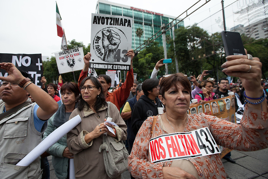 Thousands of people march to mark the one-year anniversary of the disappearance of the 43 students from Mexico's Ayotzinapa College Raul Isidro Burgos, in Mexico City, Mexico on September 26, 2015. Families of the missing and international experts cast doubt on Mexican government's official account of the incident: that municipal police handed the students over to a local drug gang who burned their bodies in a nearby garbage dump. The families asked the government to launch a new internationally supervised investigation and to review Mexico's own investigators. More than 25,000 people have disappeared in Mexico since 2007, according to the government. (Photo by Bénédicte Desrus)