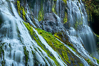A telephoto lens was used to frame an interesting interplay of diagonals crossing over the mossy rocks of Panther Creek Falls in eastern Washington.<br />