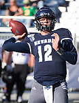 Nevada's Carson Strong (12) passes in the Nevada vs Weber State football game in Reno, Nevada on Saturday, Sept. 14, 2019.
