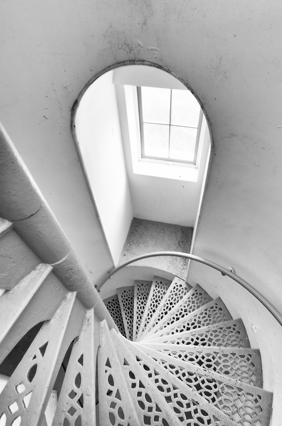 An interior view of the spiral staircase of the Point Iroquois Light which sits along the Lake Superior shoreline. Brimley, MI - Black & White