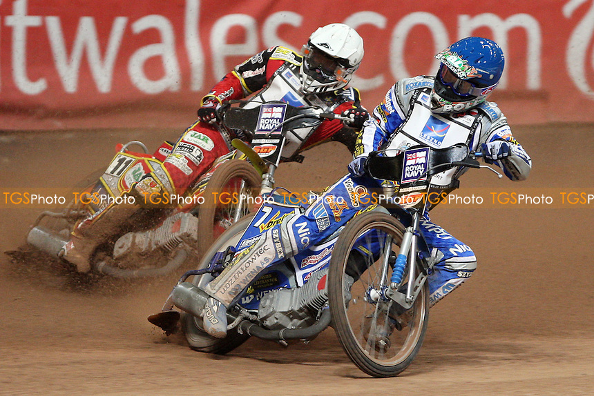 Heat 5: Rune Holta (blue) and Magnus Zetterstrom (white) - British Speedway Grand Prix at the Millennium Stadium, Cardiff - 10/07/10 - MANDATORY CREDIT: Rob Newell/TGSPHOTO - Self billing applies where appropriate - 0845 094 6026 - contact@tgsphoto.co.uk - NO UNPAID USE.