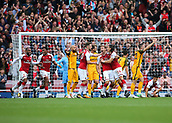 1st October 2017, Emirates Stadium, London, England; EPL Premier League Football, Arsenal versus Brighton; Nacho Monreal of Arsenal scores his sides first goal and celebrates with Hector Bellerin of Arsenal and Shkodran Mustafi of Arsenal, 1-0 Arsenal
