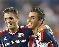 New England Revolution midfielder Diego Fagundez (14) celebrates his goal with teammates.  In a Major League Soccer (MLS) match, the New England Revolution (dark blue) defeated Philadelphia Union (light blue), 5-1, at Gillette Stadium on August 25, 2013.