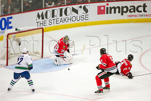 01 May 2010:   Chicago Blackhawks goalie Cristobal Huet (39) makes a block in game action.  The Vancouver Canucks defeated the Chicago Blackhawks by the score of 5-1 in the Conference Semifinals game one the  at the United Center in Chicago, IL.