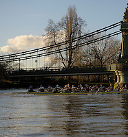 19.01.2014. River Thames, London, England. Oxford University Boat Club Trial VIIIs, both crews pass the Hammersmith Bridge. The Trial serves as part of the selection process to determine who will represent Oxford University in the 160th running of the University Boat Race on April 6th 2014. The trial for the two eights, named Persistent and Stubborn is the only occasion during the season that the squad members can race side-by-side over the full four and a quarter miles of the Championship Course between Putney and Mortlake in a simulation of The BNY Mellon Boat Race.