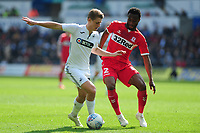 George Byers of Swansea City vies for possession with John Obi Mikel of Middlesbrough during the Sky Bet Championship match between Swansea City and Middlesbrough at the Liberty Stadium in Swansea, Wales, UK. Saturday 06 April 2019