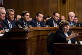 UNITED STATES - SEPTEMBER 27: Rachel Mitchell, counsel for Senate Judiciary Committee Republicans, questions Dr. Christine Blasey Ford as Senators, from left, Mike Crapo, R-Idaho, Jeff Flake, R-Ariz., Ben Sasse, R-Neb., Ted Cruz, R-Texas, Mike Lee, R-Utah., and John Cornyn, R-Texas, listen during the Senate Judiciary Committee hearing on the nomination of Brett M. Kavanaugh to be an associate justice of the Supreme Court of the United States, focusing on allegations of sexual assault by Kavanaugh against Christine Blasey Ford in the early 1980s. (Photo By Tom Williams/CQ Roll Call/POOL)