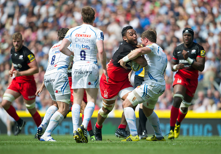 Billy Vunipola of Saracens is tackled by Dave Ewers of Exeter Chiefs<br /> <br /> Photographer Ashley Western/CameraSport<br /> <br /> Rugby Union - Aviva Premiership Final - Saracens v Exeter Chiefs - Saturday 28th May 2016 - Twickenham Stadium, Twickenham, London  <br /> <br /> World Copyright &copy; 2016 CameraSport. All rights reserved. 43 Linden Ave. Countesthorpe. Leicester. England. LE8 5PG - Tel: +44 (0) 116 277 4147 - admin@camerasport.com - www.camerasport.com
