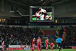 The giant scoreboard replaying home players celebrating scoring the team's third goal at the Reebok Stadium, as Bolton Wanderers take on Liverpool in a Barclays Premier League game. The match was won by Bolton by 3 goals to 1, watched by a near-capacity crowd of 26,854. The win lifted Bolton out of the relegation places in England's top division, while Liverpool remained seventh.