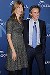 BEVERLY HILLS, CA- OCTOBER 30: Actors Laura Dern (L) and Sam Trammell arrive at the Oceana Partners Award Gala With Former Secretary Of State Hillary Rodham Clinton and HBO CEO Richard Plepler at Regent Beverly Wilshire Hotel on October 30, 2013 in Beverly Hills, California.