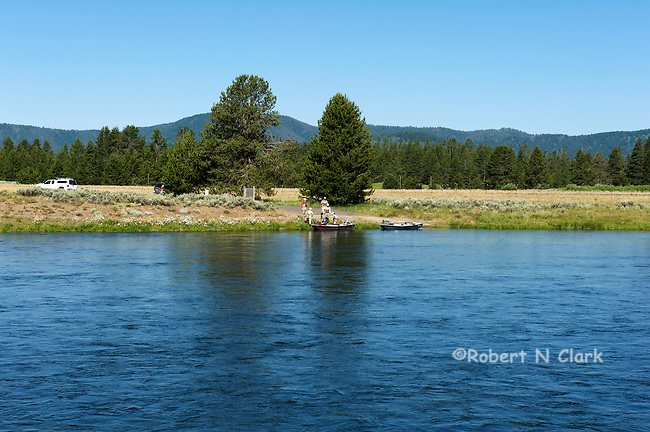 Fly Fishermen in their float boat on the Henry's Fork of the Snake River, Idaho