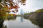 Osaka downtown Chuo-ku financial distric high-rise towers, Crystal tower and other buildings view from Osaka Castle Park canal in colorful autumn foggyscenery. Chūō-ku ward, Osaka city, Japan 2017