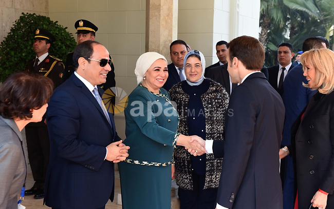 Egyptian President Abdel Fattah al-Sisi (R) and the First Lady (C) greeting the French counterpart Emmanuel Macron (L) and his wife at the presidential palace in Cairo on January 28, 2019. Photo by Egyptian President Office