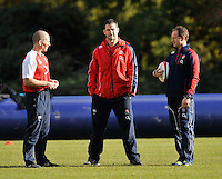 Bagshot, England. England head coach Stuart Lancaster talks with England Backs Coach Andy Farrell and  England Attacking Coach Mike Catt during the England training session held at Pennyhill Park on November 8, 2012 in Bagshot, England.