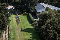 "Peloton riding a grass section<br /> <br /> Antwerp Port Epic 2018 (formerly ""Schaal Sels"")<br /> One Day Race: Antwerp > Antwerp (207km of which 32km are cobbles & 30km is gravel/off-road!)"