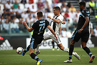 Calcio, Serie A: Juventus - Lazio, Torino, Allianz Stadium, 25 agosto, 2018.<br /> Juventus' Cristiano Ronaldo (c) in action with Lazio's Adam Marusic (l) and Wallace (r) during the Italian Serie A football match between Juventus and Lazio at Torino's Allianz stadium, August 25, 2018.<br /> UPDATE IMAGES PRESS/Isabella Bonotto