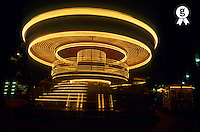 France, Marseille, spinning old fashioned carousel at night (Licence this image exclusively with Getty: http://www.gettyimages.com/detail/sb10066434k-001 )