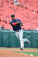 Gwinnett Braves third baseman Edward Salcedo (5) throws to first during a game against the Buffalo Bisons on May 13, 2014 at Coca-Cola Field in Buffalo, New  York.  Gwinnett defeated Buffalo 3-2.  (Mike Janes/Four Seam Images)