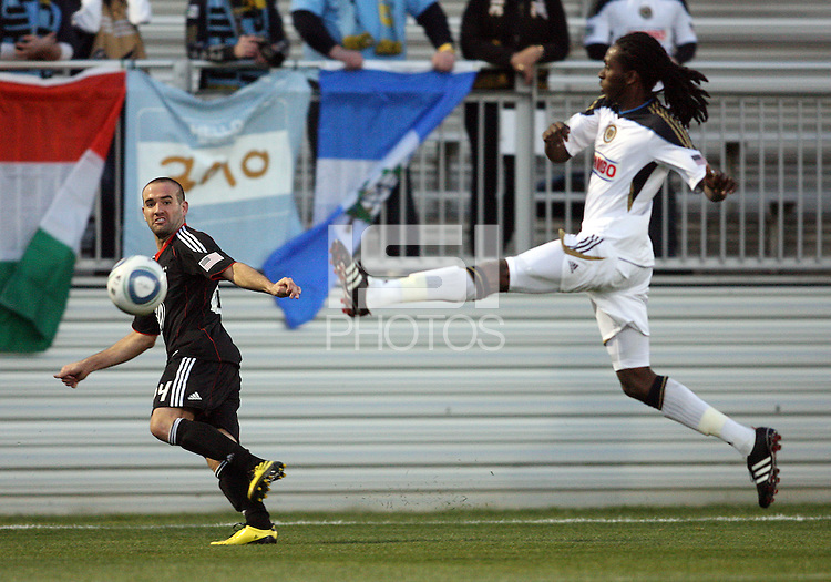 Branden Barklage(24) of D.C. United sends a cross past Keon Daniel(17) of the Philadelphia Union during a play-in game for the US Open Cup tournament at Maryland Sportsplex, in Boyds, Maryland on April 6 2011. D.C. United won 3-2 after overtime penalty kicks.