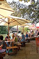 Tourists sitting outside The Trout Inn Wolvercote Oxford Oxfordshire UK..©shoutpictures.com..john@shoutpictures.com
