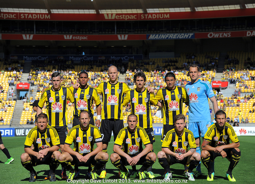 The Phoenix pose for a team photo during the A-League football match between Wellington Phoenix and West Sydney Wanderers at Westpac Stadium, Wellington, New Zealand on Sunday, 1 December 2013. Photo: Dave Lintott / lintottphoto.co.nz