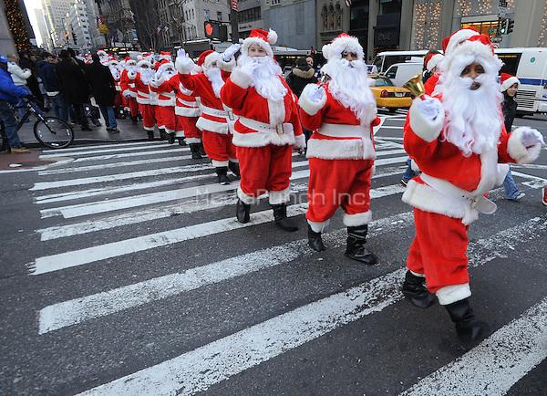 Volunteer Santas kick off the 106th Annual Parade of The Volunteers of America Sidewalk Santa program in New York City. November 28, 2008 Credit: Dennis Van Tine/MediaPunch