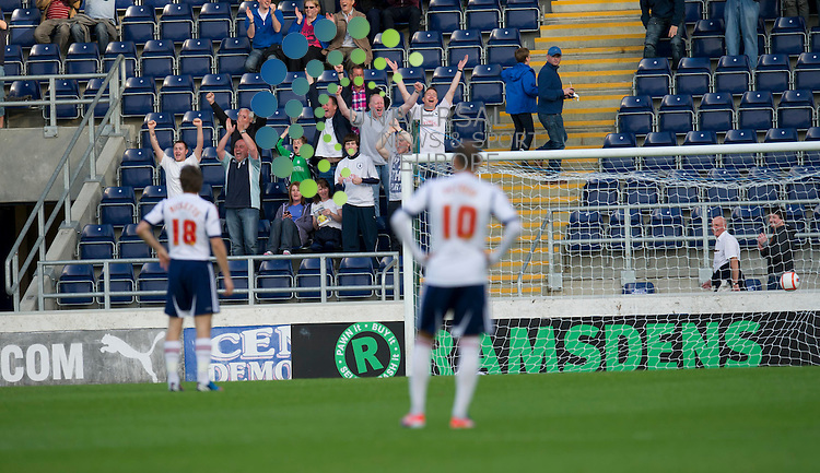 The Falkirk fans rise to acclaim a goal from Lyle Taylor during the pre-season friendly between Falkirk and Bolton Wanderers at The Falkirk Stadium. 25 July 2012. Picture by Ian Sneddon / Universal News and Sport (Scotland). All pictures must be credited to www.universalnewsandsport.com. (Office) 0844 884 51 22.