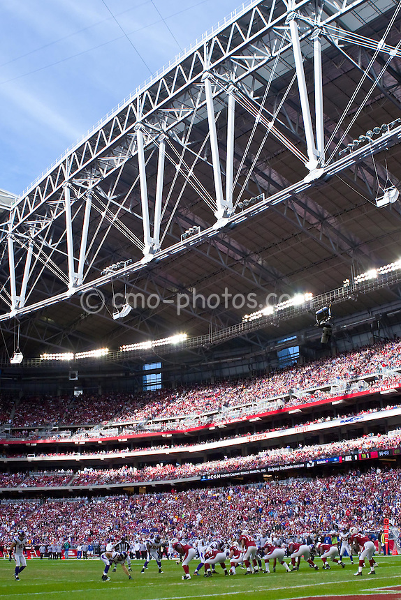 Dec 14, 2008; Glendale, AZ, USA; The Arizona Cardinals and Minnesota Vikings line up to start a play under blue skies seen through the open roof of University of Phoenix Stadium.  The Vikings won the game 35-14.