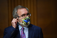 "Andrew Wheeler, Administrator, United States Environmental Protection Agency (EPA) adjusts his mask at a hearing titled ""Oversight of the Environmental Protection Agency"" in the Dirksen Senate Office Building on Wednesday, May 20, 2020 in Washington, DC. Wheeler will be asked about the rollback of regulations by the Environment Protection Agency since the pandemic started in March.    <br /> Credit: Kevin Dietsch / Pool via CNP/AdMedia"