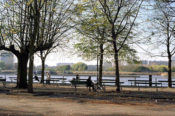 People relaxing on the Jordaenskaai on the borders of the Schelde river in Antwerp (Belgium, 08/11/2005)
