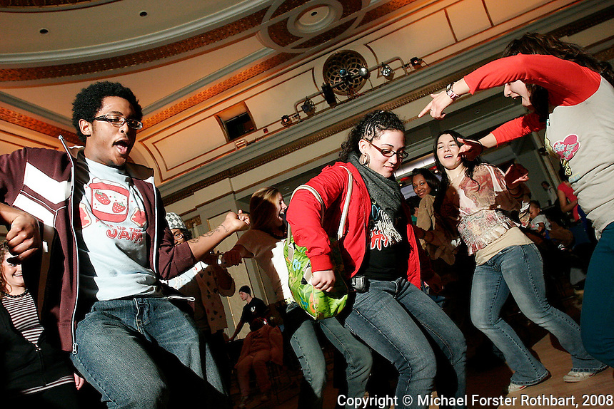 University of Wisconsin students in the First Wave Spoken Word and Urban Arts Learning Community, (L to R) Danez Smith, Sofia Snow and Alida Cardos Whaley, dance together during a monthly Hip Hop and Spoken Word open mic concert at Memorial Union called Just Bust! First Wave is a residential program that combines study of dance, visual art, theater and poetry, sponsored by the university's Office of Multicultural Arts Initiatives.  <br /> <br /> Client: Wisconsin State Journal<br /> &copy; Michael Forster Rothbart<br /> www.mfrphoto.com <br /> 607-267-4893 o 607-432-5984<br /> 5 Draper St, Oneonta, NY 13820<br /> 86 Three Mile Pond Rd, Vassalboro, ME 04989<br /> info@mfrphoto.com<br /> Photo by: Michael Forster Rothbart<br /> Date:  3/2008    File#:  Canon 20D digital camera frame 2631<br /> -------<br /> Original caption:<br /> Danez Smith, Sofia Snow and Alida Cardos Whaley (L to R), UW students in the First Wave Spoken Word and Urban Arts Learning Community, dance together during a monthly Hip Hop and Spoken Word open mic concert at Memorial Union called Just Bust! First Wave is a residential program that combines study of dance, visual art, theater and poetry, sponsored by the university's Office of Multicultural Arts Initiatives.