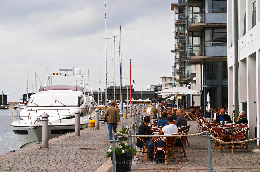 View over the very fashionable Norra hamnen, North Harbour, completely rebuilt for BoMassan Art of Living Fair with new buildings, water side cafes and shops. Helsingborg, Skane, Scania. Sweden, Europe.