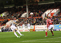 Kenny McLean heads to goal past Mark Reynolds in the Aberdeen v St Mirren Scottish Communities League Cup match played at Pittodrie Stadium, Aberdeen on 30.10.12.