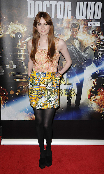 Karen Gillan.'Doctor Who: Asylum of the Daleks'  TV Preview and Q&A held at the BFI Southbank London, England..14th August 2012.Dr. Who full length black tights skirt white yellow print pattern pink orange gold top hand in pocket floral print.CAP/CAN.©Can Nguyen/Capital Pictures.