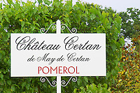A white sign in the vineyards saying Chateau Certan de May de Certan Pomerol Bordeaux Gironde Aquitaine France