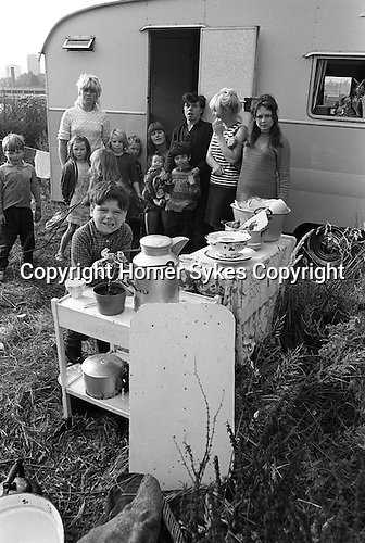 Gypsy inner city camp site Balsall Heath Birmingham UK 1968. Two mothers and their eleven children