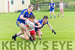 An Ghaeltacht Sean Ó Conchúir in possession of the ball tackled by Spa Shane Lynch and Eoghan Cronin during the County League Div. 2 round 11 match at Gallarus on sunday afternoon.