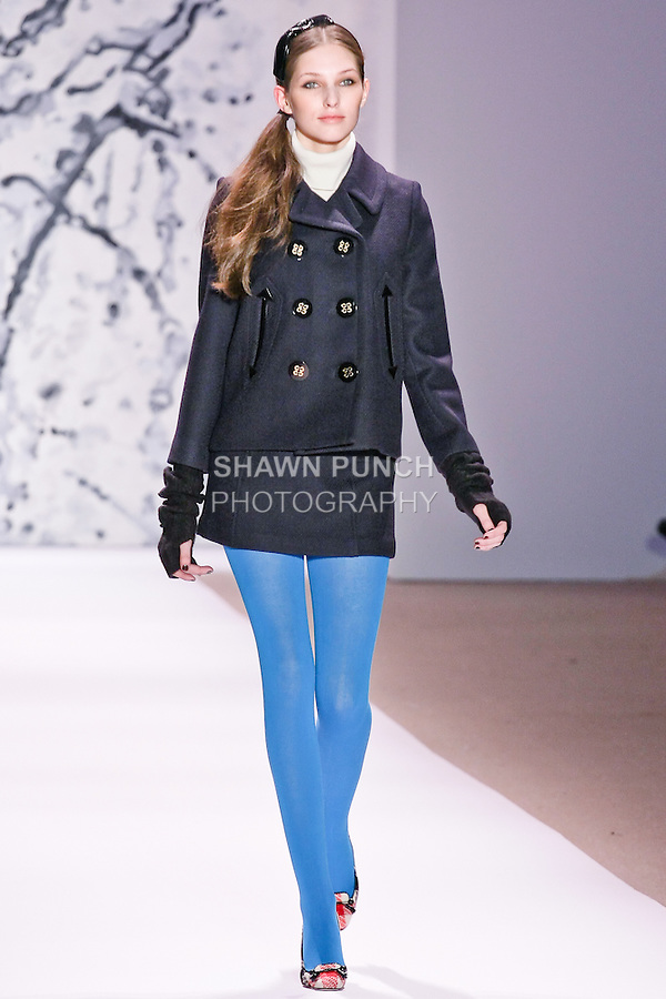 "Kelsey Van Mook walks runway in a navy double-faced wool peacoat, ivory cashmere turtleneck sweater, and navy double-faced wool mini skirt, by Michelle Smith for her Milly Fall Winter 2010 ""Classique=Moderne"" collection, during the Mercedes-Benz Fashion Week Fall 2010."