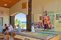 Visitors looking at artifacts and exhibitions at the Pu'ukohola Heiau National Historic Site visitor center, Kawaihae, Kohala, Big Island.