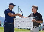 Tony Romo, left and Jonathan Thomas with the check he will donate to charity after winning the ACC Golf Tournament at Edgewood Tahoe Golf Course in South Lake Tahoe on Sunday, July 14, 2019.The former Dallas Cowboys quarterback successfully defended his title this weekend in the 30th annual celebrity championship at the Edgewood Tahoe Golf Course.