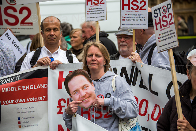 London, 28/04/2014. To mark the vote, taking place in the House of Commons (expected around 22:00), for the second reading of the HS2 Hybrid Bill, protesters gathered outside the Houses of Parliament to demonstrate against the 50 billion pounds high speed rail project which will connect London Euston to Birmingham City Centre.   <br />    <br /> For more information please click here: http://stophs2.org/