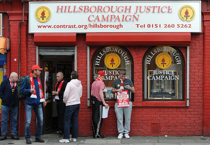 Fans outside the Hillsborough Justice Campaign office opposite Anfield, home of Liverpool FC ..Football - Barclays Premiership - Liverpool v Manchester United - Sunday 23rd September 2012 - Anfield - Liverpool..