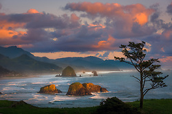A colofrul sky frames this classic postcard scene from Oregon's picturesque Cannon Beach at sunset.<br />