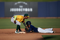AZL Athletics Gold shortstop Elvis Peralta (3) applies the tag to Jackie Urbaez (8) on a stolen base attempt during an Arizona League game against the AZL Brewers Blue on July 2, 2019 at American Family Fields of Phoenix in Phoenix, Arizona. AZL Athletics Gold defeated the AZL Brewers Blue 11-8. (Zachary Lucy/Four Seam Images)