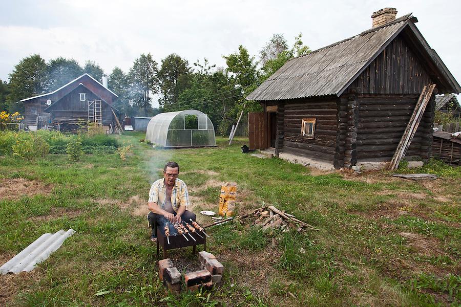 Korovikha, Ivanova Region, Russia, 04/08/2012..Pensioner Leonid Gorbach preparing pork shashlik in the garden of his home in the village of Korovikha, some 200 miles east of Moscow.