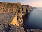 County Clare, Ireland   <br /> Sunset light on the Cliffs of Moher - a headland composed of black shale and limestone rising 650 ft abvove the sea and extending for 5 miles