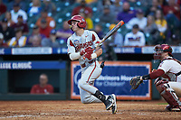 Cole Austin (16) of the Arkansas Razorbacks follows through on his swing against the Oklahoma Sooners in game two of the 2020 Shriners Hospitals for Children College Classic at Minute Maid Park on February 28, 2020 in Houston, Texas. The Sooners defeated the Razorbacks 6-3. (Brian Westerholt/Four Seam Images)